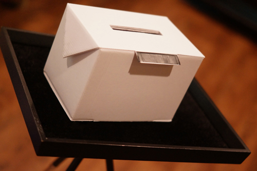 How does the origami box magic trick work